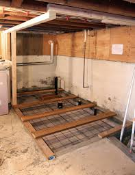 next kyle installed the rebar and welded wire mesh for the bathroom slab with a series of 2 6 planks to walk across during the pour the new concrete in