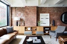 trendy mid century modern tribeca loft with exposed brick wall leather sofa and wood