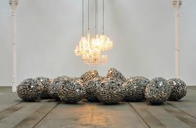 incubate 2010 25 stainless steel eggs 5 chandeliers variable dimensions installation view subodh gupta take off your shoes and wash your hands tramway