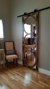 wall mirror mounted on a sliding barn track door bathroom wall mirror mounted on a sliding barn track door bathroom