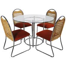 mid century daystrom round gl chrome dinette table and four wicker chairs