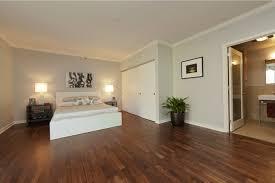 modern hardwood floor designs. 1 Modern Bedroom Composition With Hardwood Floor Min - Design Ideas Flooring Designs O