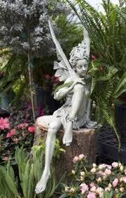 garden fairies statues. Dwarf Japanese Azaleas And Ferns Make A Great Backdrop For Garden Fairies Statues
