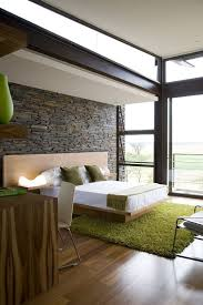 Ultra Modern Bedroom With A Stone Wall That Gives Texture To The Room