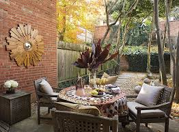 inspired sunburst mirror in patio traditional with outdoor wood privacy trellis next to outdoor brick bbq alongside outdoor mirror and best outdoor patio