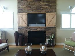 black fireplace with brown brick mantel pleted with tv