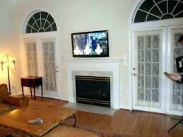hanging tv over fireplace hang over fireplace mounting above brick fireplace hiding over fireplace hang over