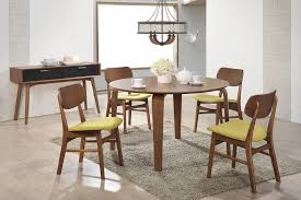dining table and chair with rounded wooden table and wooden chairs with green fabric seats