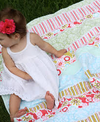 we have an awesome tutorial on how to make this adorable baby rag quilt in strips and we also have written instructions below