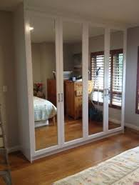 polyurethane hinged doors wardrobe with mirror inserts.JPG