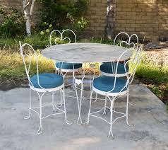 outdoor furnitures fascinating vintage white metal patio furniture high quality tubular steel frame chairs with blue round cushion solid wood table top