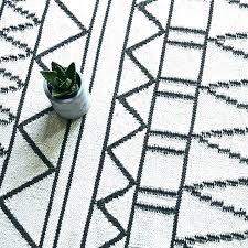 white geometric rug s gray