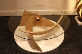 glass top any other top would diminish the beauty of this sculptural coffee table