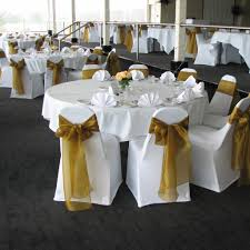 white chair covers with antique gold sashes
