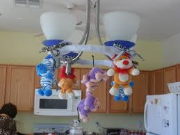what a fun jungle chandelier great way to incorporate some baby toys