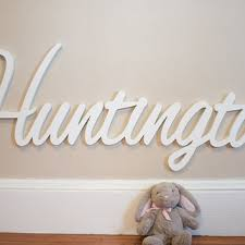 cream semi white theme wall baby name signs for nursery paired with adorable grey doll rabbit