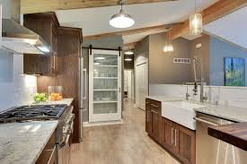 kitchen with glass panel sliding barn door in white