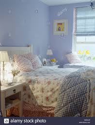 Mauve Bedroom Floral Bedlinen And Checked Quilt On Bed In Mauve Country Bedroom