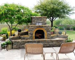 great outdoor fireplace plans between 2 big trees around the plants in backyard front chairs