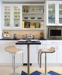 view in gallery elegant glass cabinets for a cool contemporary kitchen