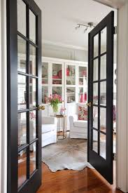 french interior doors with traditional panes look open onto a home library