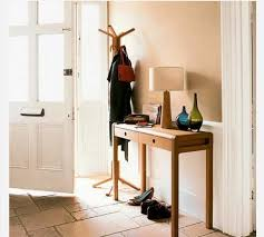 skinny entryway table. Modern Entryway Design With Wooden Console Table For Small Foyer Spaces And White Front Door Freestanding Coat Rack Drum Lamp Skinny