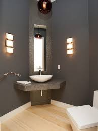 calm wall paint for small bathroom with cool wall lamp near tiny mirror closed white sink under pendant lighting bathroom vanity and wooden floor best pendant lighting
