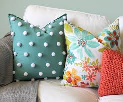 throw pillows are my favorite way to add color and personality to a room and this polka dot pom pom pillow is definitely full of personality