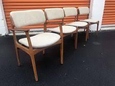 set of 4 solid teak danish dining chairs by erik buch buck mid century