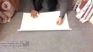 fitting anti slip rug underlay on carpet by the oriental rug gallery