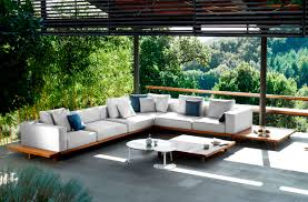 impressive teak outdoor furniture collections amazing sectional white sofa and round coffee table settled on