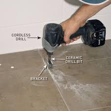 attaching brackets to a bathroom floor