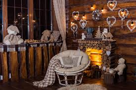 bulbs garland lights and decorativa hearts at the wooden boards wall above firewood fireplace