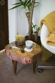 a full image of the diy wood stump side table next to a mod leather egg