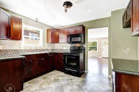 white kitchen dark tile floors. Fake Wood Flooring Idea In Brown White Ceramic Tile Floor Modern Kitchen Dark Floors