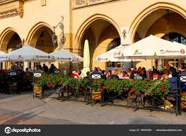 Krakow poland may 2017 nearby colonnade outdoor restaurant old town stock photo