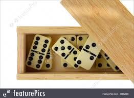 and domino in wooden box against the white background