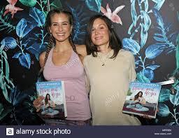 24 May 2018, Germany, Munich: Model Cathy Hummels (L) and yoga ...