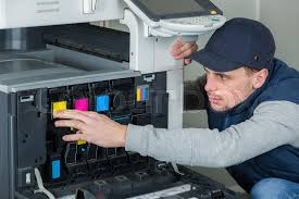 Printer Technician Technician Changing Ink Cartridge In Stock Image
