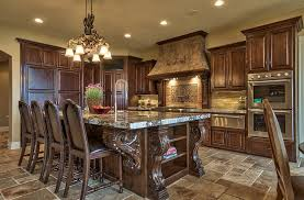 View in gallery Ornate kitchen design with a Tuscan-inspired island [Design:  Inspired Interiors]