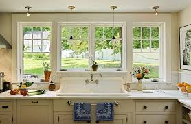 kitchen sink st louis with traditional kitchen and glass pendants marble backsplash marble countertop painted cabinets pendants porcelain sink traditional