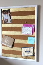 View in gallery Cork board with gold painted stripes