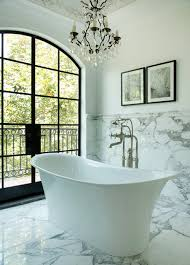 freestanding bathtub mediterranean white tile and marble tile freestanding bathtub idea in los angeles