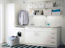 ... A Laundry Room With White Wall Shelves Base Cabinets With Doors Or  Drawers And Grey Floor ...