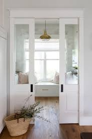 two glass panel pocket doors at kitchen pantry