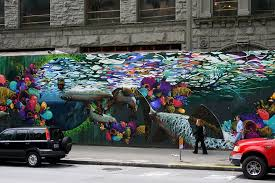 in the capitol hill neighborhood you ll find this mural on the side of an old seattle service station which is now a loft building  on best wall art in seattle with seattle s best murals art in the real world