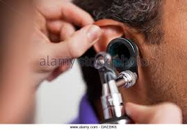 Image result for nurse using otoscope