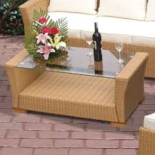 light brown resin wicker and teak wood feet glass top 43 w x 22 d s 17 h coffee table