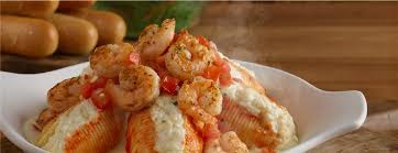 giant stuffed s with shrimp topped with alfredo sauce and seasoned tomatoes