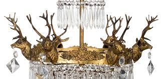 6 arm gold stag head chandelier with icicle droplets